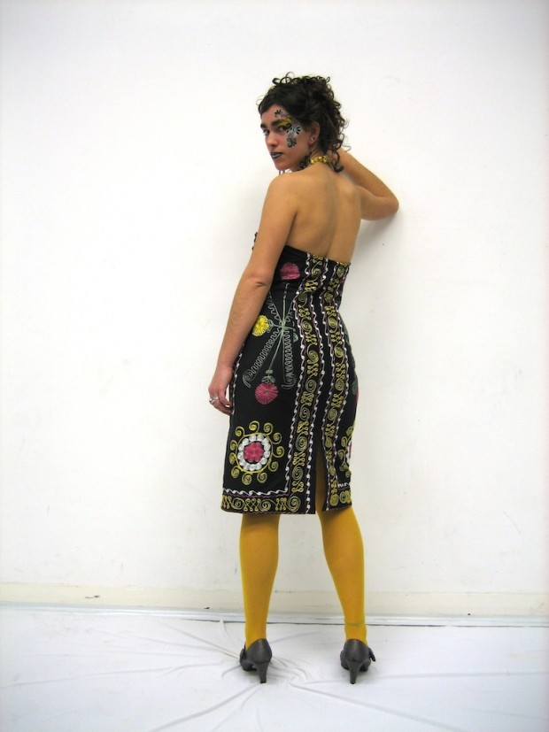 emboidered bed throw made into a stapless dress