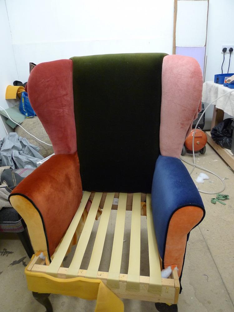 reupholstered velvet wingback chair in progress